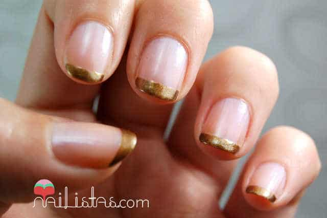 Manicura francesa de color dorado