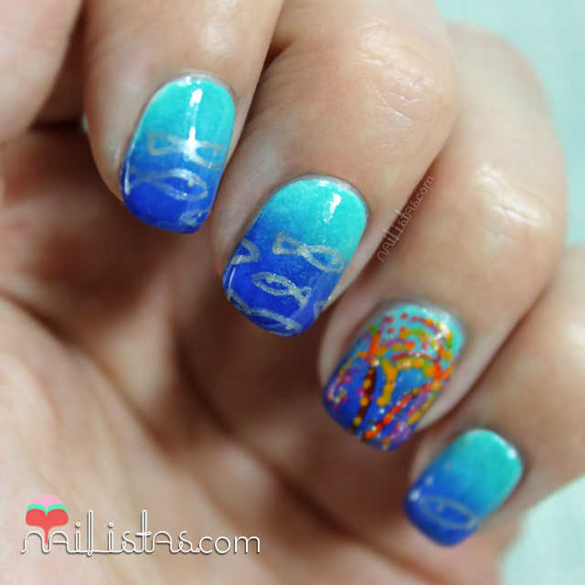 Nail Art design con peces y fuegos artificiales