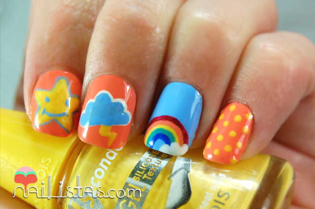 Uñas decoradas con arcoiris, nube y estrellas inspiradas en los osos amorosos