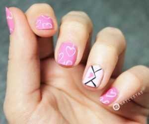 Manicura de corazones para San Valentin uñas cortas