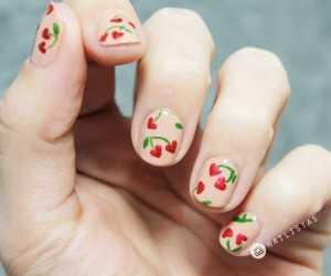 Nail art para uñas cortas con corazones para el día de los enamorados.