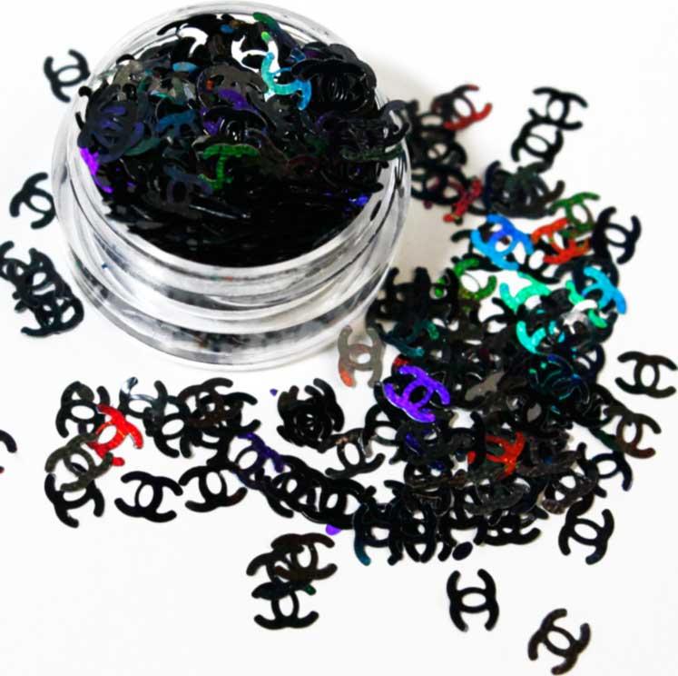 purpurina para nail art con forma de logo de chanel